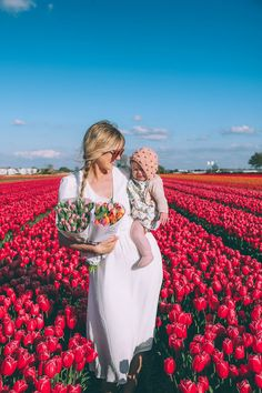 Tulip Fields and Windmills in Holland - Barefoot Blonde by Amber Fillerup Clark Baby Bunting, Holland Windmills, Amber Fillerup, Tulip Festival, Barefoot Blonde, Tulip Fields, Photography Poses Women, Red Photography, Maternity Pictures