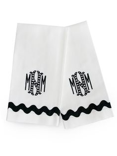 "White cotton pique Guest Towels with black jumbo ric rac and ""Cooper"" monogram in black."
