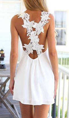 Kind of in love with this white lace criss cross mini dress