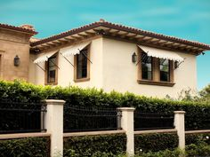 Spear awnings, scroll awnings and ball-tip awnings in vibrant UV-rated outdoor fabrics. Window Awnings, Retractable Awning, Mediterranean Homes, Spanish Colonial, Outdoor Fabric, Exterior Design, Windows, Mansions, House Styles