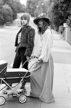 Pop star David Bowie with wife Angie and three week old son Zowie. He is modelling an Oxford Bags dress, Turkish cotton shirt and a felt hat. Angela is wearing the very same Damier printed fur coat that Bowie wore during the Hunky Dory photo session. All pictures by Ron Burton, 29th June 1971