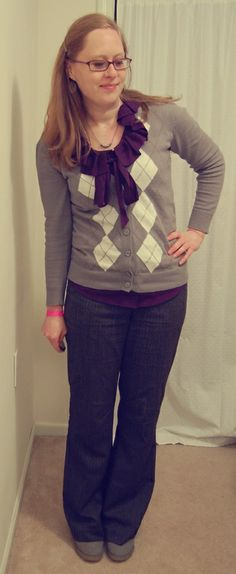 Gray argyle cardigan, plum blouse w ruffle, dark gray tweed pants, gray shoes, simple silver necklace.