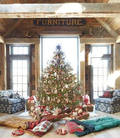 """With """"campouts"""" by the tree and annual s'mores parties around the fire, find out how one family has mastered the art of the at-home holiday getaway. Tour the home: A Homespun Christmas in a Cozy Connecticut Farmhouse"""
