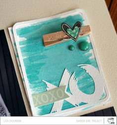 making embellishments with watercolours and designs cut from white cardstock with the silhouette.  scrapbooking video by Lisa Dickinson.