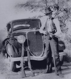 Clyde Barrow, of Bonnie & Clyde fame, holding a Browning automatic rifle. BAR's could fire a   twenty-shot magazine loaded with armor-piercing ammunition in under three seconds.