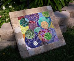 Still pluggin along on my mosaic garden rug.  :)