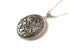 Hey, I found this really awesome Etsy listing at https://www.etsy.com/listing/153974725/antique-locket-silver-oval-locket-with
