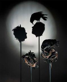 Eerie Shadow Projection Trash Sculptures