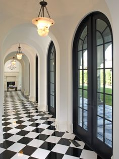 hallway, arched French doors, black & white marble floor