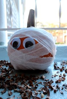 WIDE-EYED & MUMMIFIED Not every pumpkin needs to be carved.  How about wrapped?