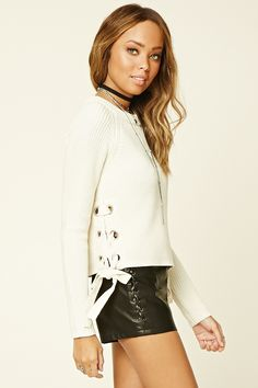 A midweight knit sweater with a crew neckline, long sleeves, and lace-up sides with high-polish grommets.