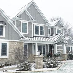 Grey and stone shingle style home. Cape cod home. White columns and grey metal roof. Caroline on Design home exterior materials so you can recreate the look of her gray shake shingle cape cod style home exterior. House Paint Exterior, Exterior Siding, Dream House Exterior, Exterior House Colors, Grey Siding House, Exterior Remodel, Stone On House Exterior, Hardie Board Siding, Gray Siding