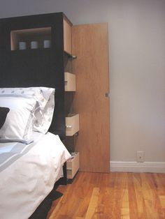 I really like this idea, imagine storing all you sheets and extra pillows and thing here.  Convenient!