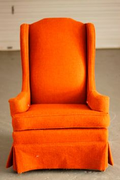 Vintage High Back Slim Line Orange Wing by TheSouthernMermaid on etsy.com. Reminds me of the old orange furniture my family had when I was a child, but this is much more sophisticated.