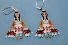 "This pair of earrings I made, are called, ""Fancy Dancer."" They are made with hex beads and shine!"