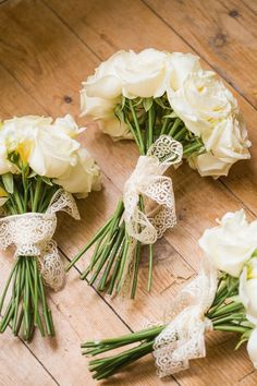 White Rose Bouquet wrapped with lace for bridesmaids || See the wedding on SMP: http://www.StyleMePretty.com/2014/02/20/french-chateau-destination-wedding/ M & J Photography