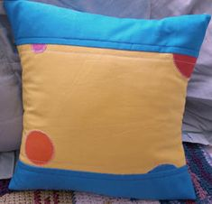 pillow made from custom made fabric to match a changing bag and snack bag