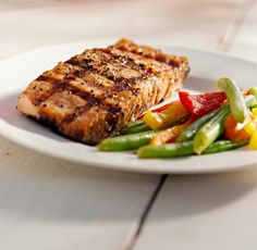 Asian-Style Grilled Fish Ingredients ½ cup Moore's Original Marinade ½ cup dry white wine 3 cloves crushed garlic 2 tbsp sesame oil 1 tbsp grated ginger root 2 6oz salmon fillets