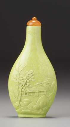 A CARVED LIME-GREEN GLAZED PORCELAIN 'LANDSCAPE' SNUFF BOTTLE WANG JIEMEI, LATE QING DYNASTY / EARLY REPUBLICAN PERIOD
