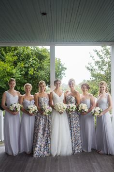 Bridesmaid dresses: Printed: Alice & Olivia, Solid: Amsale Bridesmaid gift: Tiffany pearl drop earrings. Groomsmen gift: Colorful socks and suspenders.   - TownandCountryMag.com