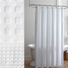 Pique II Shower Curtains by Peacock Alley. White shower curtains with a colored trim detail along the bottom and a tailored edge. Comes in 14 colors.