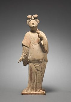 Woman Holding Plum Blossoms: Tomb Figurine, early 8th Century China, Tang dynasty (618-906) earthenware covered in white slip with traces of pigment, Overall - h:43.80 w:16.50 d:12.20 cm (h:17 3/16 w:6 7/16 d:4 3/4 inches). John L. Severance Fund 1987.13