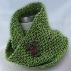 Spring green infinity scarf handknit with lacey effect of a slipstitch