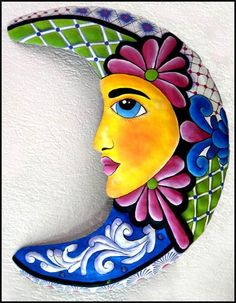 moon face                                                             Brightly Hand Painted Metal Moon Wall Hanging by TropicalMetal. $29.95, via Etsy.