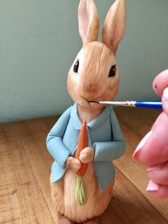 Learn how to create a Peter Rabbit figurine out of modeling chocolate with this tutorial; perfect for a Peter Rabbit themed cake. Peter Rabbit Figurines, Peter Rabbit Cake, Peter Rabbit Birthday, Fondant Rabbit, Fondant Cupcakes, Easter Cupcakes, Baby Boy Birthday, Birthday Cakes, Rabbits