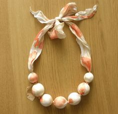 another cute type of necklace is made from oversized beads and cloth like this cute one found on etsy!