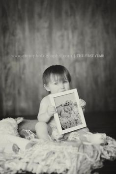 1 year photos holding a photo from your newborn session! Www.eieiophotography.com