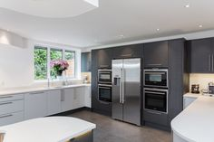 Curved Metris Kitchen With Gloss Dove Grey units contrasting with Textured Graphite Units.