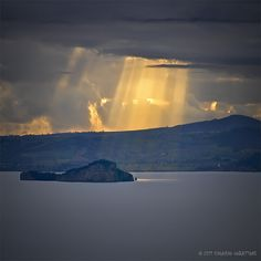 rays of fire. Lake Bolsena, Italy.