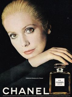 An original 1973 advertisement for Chanel No. 5 perfume. Featuring Catherine Deneuve in a full size color photo print. -1973 Chanel No. 5 perfume advertisement - An original, not a reproduction -Measu
