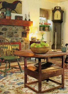 Prims...stone fireplace, grandfather clock & table.
