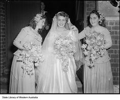 Before her wedding bride Miss Vivienne Wheeler with her bridesmaids Miss Joan Hammond (left) and Miss June Wheeler, 22 January1950