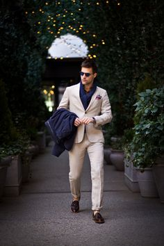316e56416834 Make a stylish entry anywhere you go in a navy trench and cream chinos.  Consider oxblood leather tassel loafers as the glue that will bring your  look ...