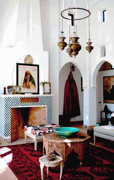 Moroccan-inflected living room with lantern chandelier, fireplace, and rug.
