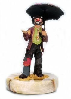 Emmett Kelly Jr Chance of Rain Figurine. Emmett is holding an umbrella as the forecast predicts rain. This figurine is limited to only 1500 pieces. Each Emmett Kelly Jr figurine is made of pewter, hand painted, comes mounted on an onyx base and is signed by the artist Ron Lee. All of the Ron Lee Emmett Kelly Jr sculptures are Made in the USA. $114.99 #Clowns #EmmettKellyJr #Clown #Emmett