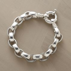 "HANDMADE SILVER LINK BRACELET -- Forged by hand from thick, weighty sterling silver, our classic link bracelet has both power and polish. Bold closure adds distinctive design. 8""L."
