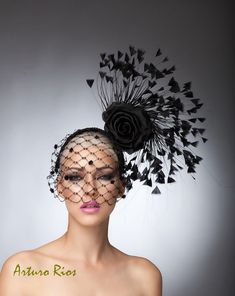 From my Spring/summer collection here is one of my favorites headpieces, love the composition and details, Made on a 2 1/2wide headband covered with a beautiful Guipure black lace ,adorned with turkey feathers,2 silk roses and hexagonal veil with vintage velvet dots.  if you like to impress you should definitely wear this and all eyes will be on you :)  All my hats are hand made by request, please allow one week, while we make and ship it. If this is a rush order please contact me first. All…
