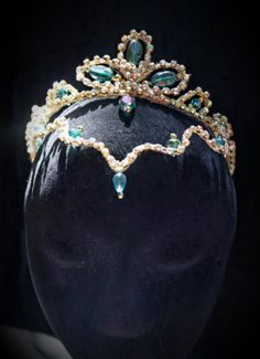A wonderful hand made, professional ballet headpiece suitable for roles such as The Odalisques in Corsaire, Medora, Gulnara, or La Bayadere. This tiara features a golden crown decorated with turquoise