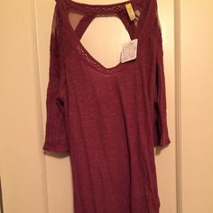 Free People top brand new never worn with tags. asymmetrical bottom hem with an open lace cutout in the back. maroon color Free People Tops Blouses