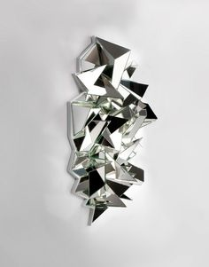 Froissé (hurt) by Mathias Kiss is a fractured mirror currently on display at Galerie Armel Soyer in Paris.