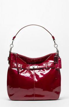 Seriously love shiny wine/silver purse.... must find knock off...