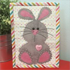 Hippity, hoppity, the Easter Bunny is coming! This is a great mug rug for your sewing space, a gift for a quilty friend or send it as a postcard! Finished M