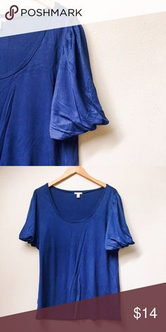 NWOT Old Navy Top Dark blue, nearly navy, Old Navy top, silky smooth with a scooped neck and tucked under sleeve detail. New without tags.  ✅Offers On Items Over $10 ✅Bundle & Save 🚫Trades 🚫Off-Posh 🚫Modeling  💞Shop with ease; I'm a Suggested User.💞 Old Navy Tops