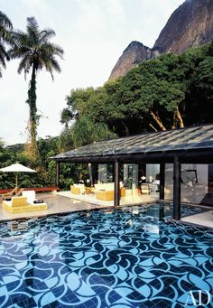 sky-high cliffs add natural drama to this tropical oasis