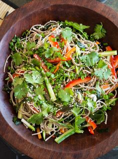This spicy soba noodle salad with carrots, bell peppers, and cucumbers is a light and refreshing dish perfect for lunch or dinner.