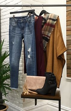 Now this is layering 101! Start with your favorite denim, add a sleeveless tee, grab a poncho, flip on a scarf, kick on those booties and grab your clutch! Out the door you go! #smart #style #chic #ApricotLaneTS #ShopALB  $48 JUSTUSA Frayed and Distressed skinny jean $36 ENCREME Burgundy Sleevelss Top $42 One The Land Camel Poncho $18 Blanket Scarf $52 Black Buckled Bootie $48 Tan Tassel Clutch